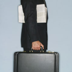 Businessman Carrying Briefcase and Newspaper
